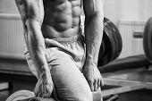 picture of abdominal muscle  - A man pumping abdominal muscles in the gym - JPG