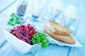 stock photo of beet  - beet salad in bowl and on a table - JPG