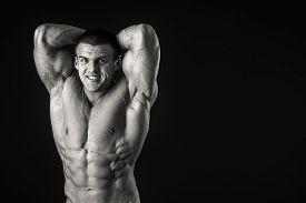 image of strongman  - Strongman on a black background - JPG