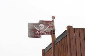 picture of skull crossbones flag  - White skull with twin swords on Flag Priate wooden in white background - JPG
