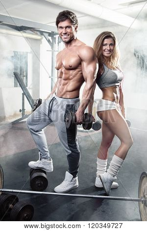 Beautiful Young Sporty Sexy Couple Workout In Gym Poster ...