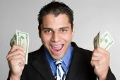 stock photo of spanish money  - Excited Man Holding Money - JPG