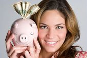 picture of save money  - Woman Holding Piggy Bank - JPG