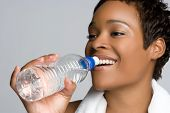 stock photo of young black woman  - Black Woman Drinking Water - JPG