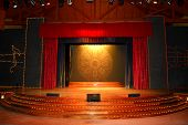 pic of stage theater  - Stage with red curtains and spotlights on the stage floor - JPG