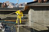 stock photo of pressure-wash  - Building Construction Site - Contractor on Scaffolding