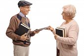 Elderly man and an elderly woman exchanging books isolated on white background poster