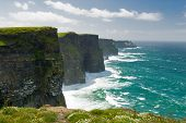 stock photo of cliffs moher  - The Cliffs of Moher in County Clare are one of the tallest sea cliffs in Ireland and is a popular tourist destination - JPG