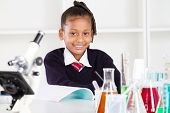 happy female elementary school pupil in science class