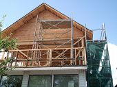 stock photo of home addition  - addition  being added to a existing house construction - JPG
