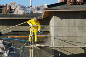 stock photo of pressure-wash  - Building Construction Site - Contractor on Scaffolding ** Note: Slight blurriness, best at smaller sizes - JPG
