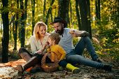 Mother Father And Small Son Picnic. Picnic In Nature. Country Style Family. Meaning Of Happy Family. poster