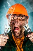 stock photo of electrician  - Electric shock sees a shocked electrician man - JPG