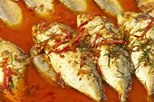 Fish fried in a spicy sauce poster