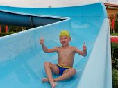 Boy Rides Water Slide Rides At The Water Park poster