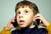 Child Wearing Headphones 2 poster