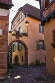 Medieval Small Town Kaysersberg , Region Alsace. France. Narrow Street Of Old Town With Colorful Sto poster