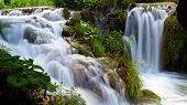 waterfall with lake and nature, slow motion poster
