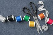 Sewing Items: Tailoring Scissors, Measuring Tape, Spools Of Multicolored Threads. Sewing Accessories poster