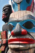 foto of totem pole  - Lively historic totem poles by ancient native indian americans in the stanley park - JPG