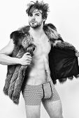 Fashion Concept. Richness And Luxury Lifestyle. Sexy Sleepy Rich Macho Tousled Hair Fur Vest On Whit poster