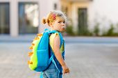 Cute Little Adorable Toddler Girl On Her First Day Going To Playschool. Healthy Upset Sad Baby Walki poster