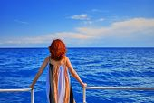 Behind Girl On Pier. Beautiful Red Head Woman On The Pier At The Sea. poster