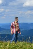 Hiking Concept. Power Of Nature. Man Unbuttoned Shirt Stand Top Mountain Landscape Background. Muscu poster