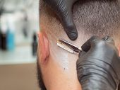 Hairstylist Shaving Clients Neck With Straight Razor, Close Up View. Hands In Black Rubber Gloves Wi poster