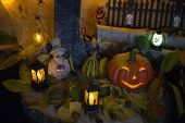 Halloween Decorations Concept At Night. Close Up Of Jack Olantern, Vintage Lanterns, Pumpkins, Skul poster