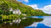 Kylemore Abbey, Beautiful Castle Like Abbey Reflected In Lake At The Foot Of A Mountain. Benedictine poster