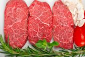 stock photo of shabu  - raw fresh Kobe Miyazaky beef with rosmary and marjoram - JPG