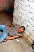 picture of crack cocaine  - Overdose addict against the basement - JPG