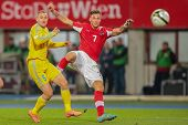 VIENNA,  AUSTRIA - OCTOBER 16: Mark Gurman (#5 Kazakhstan) and Marko Arnautovic (#7 Austria) fight f