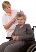 pic of crippled  - Nurse dressing the hair of a senior woman - JPG