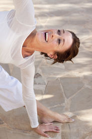 picture of tantra  - A flexibel middle age senior woman doing yoga - JPG