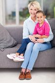 stock photo of lap  - cute little granddaughter sitting on grandma - JPG