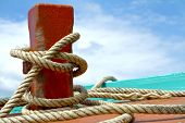 pic of bollard  - Ship hemp cable bound over a mooring bollard - JPG