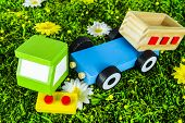 stock photo of truck-cabin  - Crushed toy truck on a grass background
