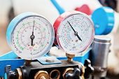 stock photo of gage  - manometers on equipment for filling automotive air conditioners