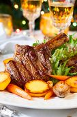 stock photo of veal  - Veal chop with vegetables for Christmas dinner - JPG