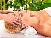 foto of beauty parlour  - Woman getting facial massage in tropical beauty spa - JPG