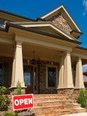 foto of model home  - Luxury Model Home angled entrance with Open signage - JPG