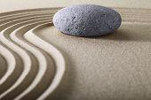 image of zen  - zen garden japanese garden zen stone with raked sand and round stone tranquility and balance ripples sand pattern - JPG