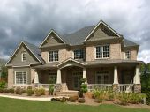 Luxury Model Home Exterior Stormy Weather poster