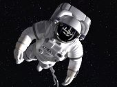 stock photo of spaceman  - The astronaut in outer space against stars - JPG
