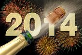stock photo of alcoholic beverage  - happy new year 2014 with popping champagne and fireworks - JPG