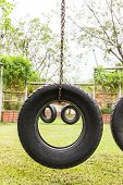 picture of tire swing  - Tyre swing playground location in garden  Thailand - JPG