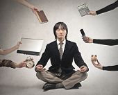 stock photo of discipline  - japanese businessman is meditating to relieve stress - JPG