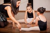 image of leotards  - Pretty Hispanic little girls listening to her dance instructor directions during a dance class - JPG